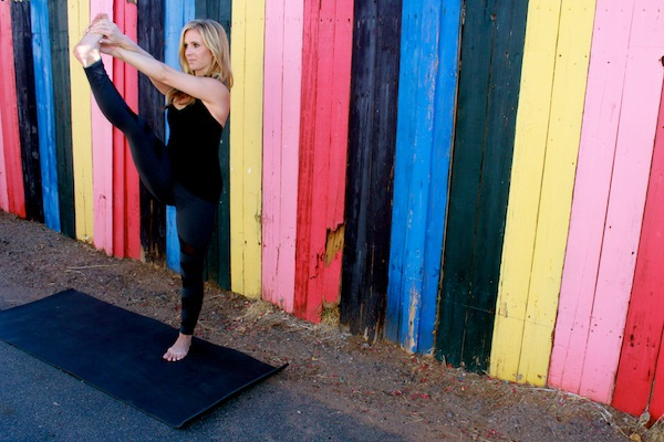 Gina Marciano strikes and yoga pose... and shares her fit faves