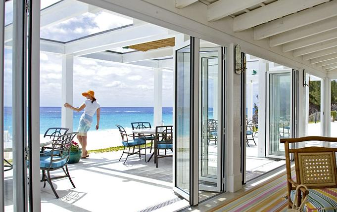Glass doors by nanawall open up the room and let the Opening glass walls