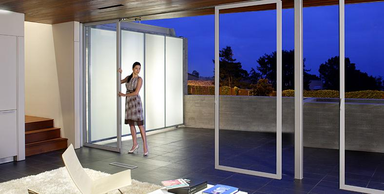Glass doors by nanawall open up the room and let the Sliding glass wall doors